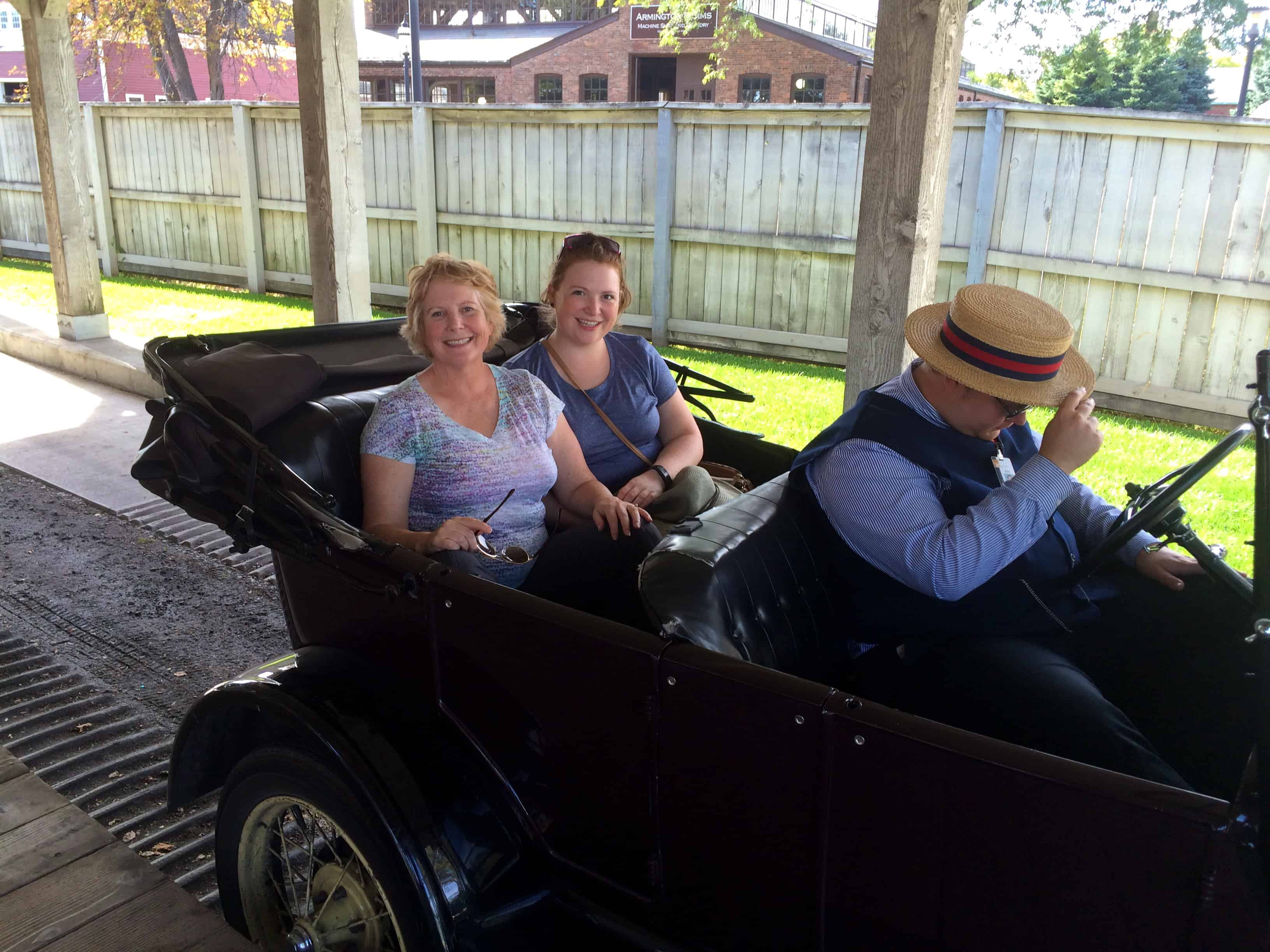 Riding a Model-T through Greenfield Village.